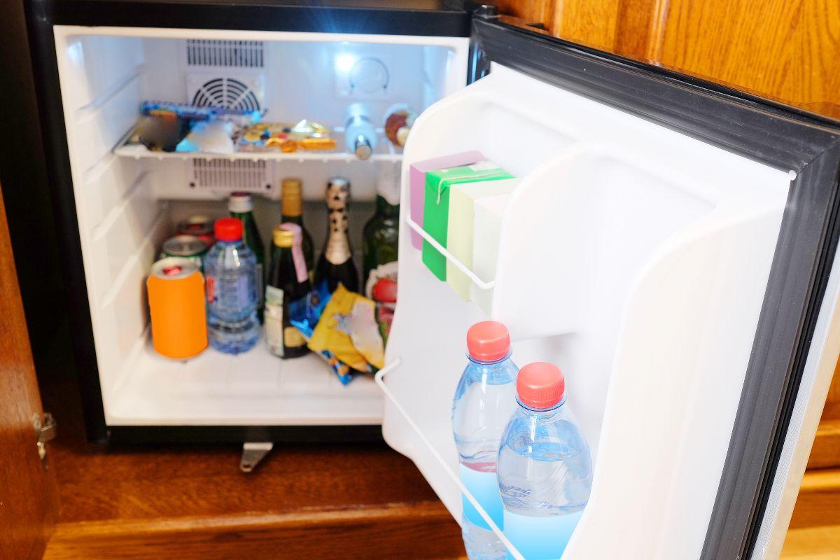 Open fridge with cool drinks inside